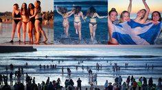 นักศึกษา พร้อมใจกันเปลื้องผ้ากระโดดลงทะเล ตามประเพณีของมหาวิทยาลัยในสกอตแลนด์