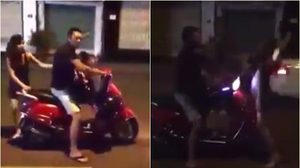 อันตราย! คลิปหญิงชายตีกันกันกลางถนน ปล่อยลูกน้อยนั่งร้องไห้โฮ