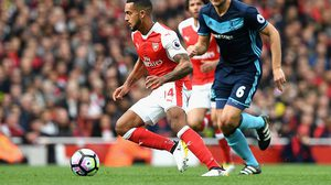 LONDON, ENGLAND - OCTOBER 22:  Theo Walcott of Arsenal (L) is chased by Ben Gibson of Middlesbrough (R) during the Premier League match between Arsenal and Middlesbrough at the Emirates Stadium on October 22, 2016 in London, England.  (Photo by Shaun Botterill/Getty Images)