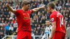 NEWCASTLE-UPON-TYNE, ENGLAND - OCTOBER 19: Steven Gerrard (L) of Liverpool celebrates scoring his 100th Premier League goal and his team's first with team-mate Jordan Henderson during the Barclays Premier League match between Newcastle United and Liverpool at St James' Park on October 19, 2013 in Newcastle-Upon-Tyne, England. (Photo by Paul Thomas/Getty Images)