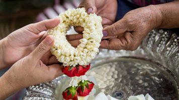 hands giving a garland