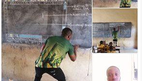 ครูชาวกาน่า วาดหน้าจอคอมพิวเตอร์บนกระดานดำ เพื่อใช้เป็นสื่อการสอน