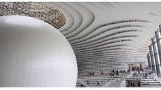 Tianjin Binhaiเป็นยิ่งกว่า ห้องสมุด ด้วย สถาปัตยกรรม สุดปัง ในประเทศจีน