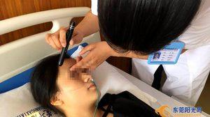 สาวจีนดวงซวย!! เล่นเกมส์บน สมาร์ทโฟน หนักไปหน่อย จนถึงขั้นตาบอด