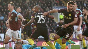 Manchester City's Argentinian striker Sergio Aguero (3rd R) reacts after scoring their first goal during the English Premier League football match between Burnley and Manchester City at Turf Moor in Burnley, north west England on November 26, 2016. / AFP / Oli SCARFF / RESTRICTED TO EDITORIAL USE. No use with unauthorized audio, video, data, fixture lists, club/league logos or 'live' services. Online in-match use limited to 75 images, no video emulation. No use in betting, games or single club/league/player publications.  /         (Photo credit should read OLI SCARFF/AFP/Getty Images)