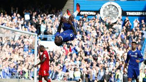 Chelsea's Nigerian midfielder Victor Moses (C) celebrates after scoring their third goal during the English Premier League football match between Chelsea and Leicester City at Stamford Bridge in London on October 15, 2016. / AFP / Adrian DENNIS / RESTRICTED TO EDITORIAL USE. No use with unauthorized audio, video, data, fixture lists, club/league logos or 'live' services. Online in-match use limited to 75 images, no video emulation. No use in betting, games or single club/league/player publications.  /         (Photo credit should read ADRIAN DENNIS/AFP/Getty Images)