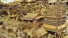 ศิลปินชาวจีน  กับการ แกะสลักไม้ ท่อนเดียวยาว ที่สุดในโลก