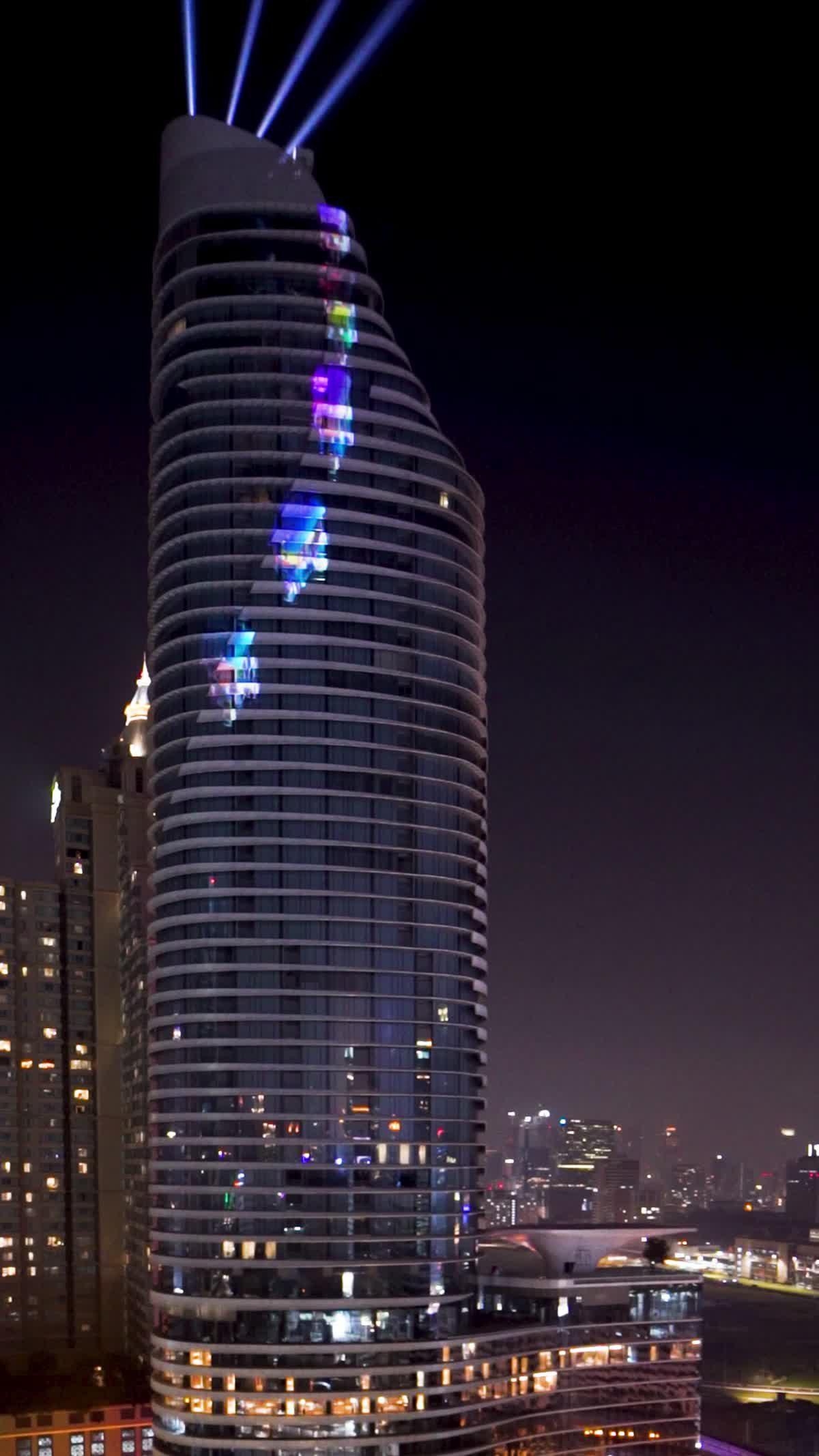 ครั้งแรกในไทย แสง สี 3 มิติ 3D Projection Mapping บนตึกสูง 60 ชั้น โดย แมกโนเลีย