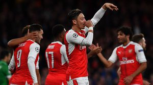 Arsenal's German midfielder Mesut Ozil (C) celebrates scoring his hat trick, and his team's sixth goal, during the UEFA Champions League Group A football match between Arsenal and Ludogorets Razgrad at The Emirates Stadium in London on October 19, 2016. / AFP / BEN STANSALL        (Photo credit should read BEN STANSALL/AFP/Getty Images)