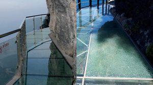 เกือบเป็นเรื่องใหญ่!! นักท่องเที่ยวมือบอนใช้ก้อนหินทุบ สะพานกระจก ริมหน้าผาในไต้หวัน
