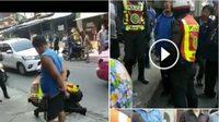 วิจารณ์สนั่น! ตำรวจรวบหนุ่มยืนถ่ายรูป ชาวบ้านงงทำผิดอะไร?