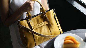 4 เคล็ดลับฉบับกูรู ที่ช่วยให้คุณโบกมือลากระเป๋า Longchamp ปลอมๆ ไปได้เลย